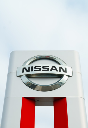 automobile dealership: COSTA MESA, CAUSA - OCTOBER 17, 2015: Nissan Motors automobile dealership and sign.  Nissan Motors is is a Japanese multinational automotive manufacturer headquartered in Japan.