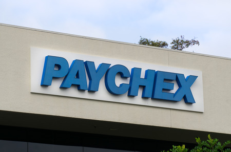 accounting logo: COSTA MESA, CAUSA - OCTOBER 17, 2015: Paychex corporate building. Paychex, Inc. is a provider of payroll, human resource, and benefits outsourcing solutions.