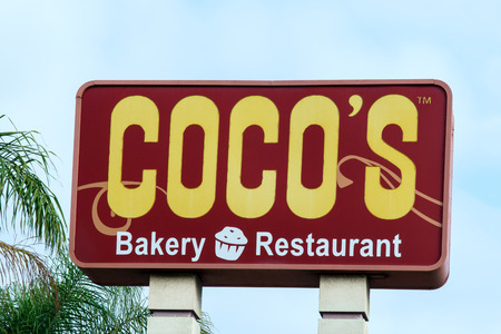 cocos: COSTA MESA, CAUSA - OCTOBER 17, 2015: Cocos Bakery Restaurant sign. Cocos  is a chain of restaurants in the United States. Editorial