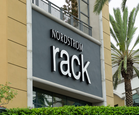 thrifty: COSTA MESA, CAUSA - OCTOBER 17, 2015: Nordstrom Rack retail store exterior. Nordstrom, Inc. is an American upscale fashion retailer.