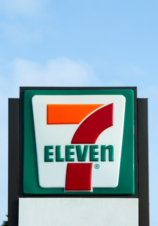 COSTA MESA, CAUSA - OCTOBER 17, 2015: 7-Eleven store exterior and sign. 7-Eleven is the worlds largest operator and franchisor of convenience stores.