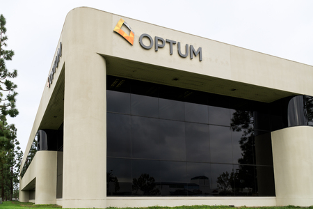 health care analytics: COSTA MESA, CAUSA - OCTOBER 17, 2015: Optum corporation headquarters and logo. Optum is a division of United Healthcare, Inc. Editorial