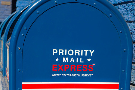 united states postal service: LOS ANGELES, CAUSA - NOVEMBER 8, 2015: Priority Mail Express mailbox. Priority Mail Express is a service of the United States Postal Service.