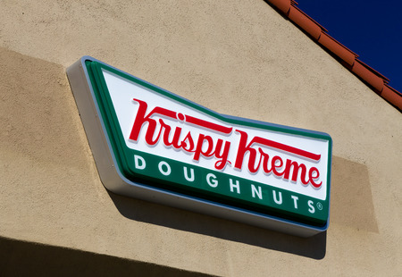 LOS ANGELES, CAUSA - November 11, 2015: Krispy Kreme Doughnuts exterior and logo. Krispy Kreme Doughnuts, Inc. is an American global doughnut company and coffeehouse chain. Editorial