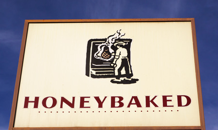 retailer: LOS ANGELES, CAUSA - December 6, 2015: HoneyBaked Ham restaurant sign and logo. HoneyBaked Ham is a food retailer founded in 1957.