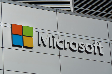 microsoft: LOS ANGELES, CAUSA - December 6, 2015: Microsoft logo and emblem. Microsoft is a multinational corporation that develops, supports and sells computer software and services.
