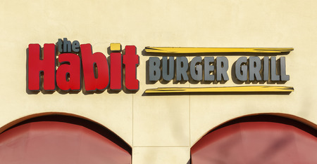 habit: SANTA CLARITA, CAUSA - DECEMBER 28, 2015: The Habit Burger Grill exterior and logo. The Habit is a fast casual restaurant chain. Editorial