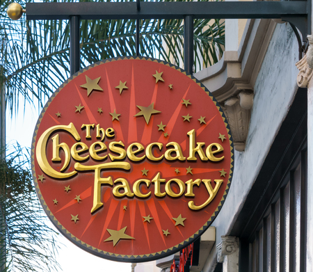 eating cake: PASADENA, CAUSA - OCTOBER 4, 2015: Cheesecake Factory restauruant sign. The Cheesecake Factory, Inc. is a distributor of cheesecakes and restaurant company.