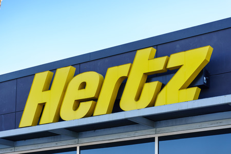 car salesperson: PASADENA, CAUSA - JANUARY 2, 2016: Hertz sign. The Hertz Corporation is an American car rental company. Editorial