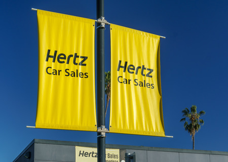hertz: PASADENA, CAUSA - JANUARY 2, 2016: Hertz Car Sales sign. The Hertz Corporation is an American car rental company. Editorial