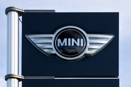 cooper: VALENCIA, CAUSA - JANUARY 13, 2016: MINI Cooper automobile dealership sign and logo. MINI Cooper is a brand of car made by BMW. Editorial