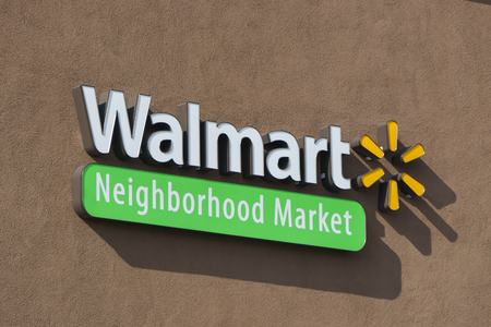 walmart: ALTADENA, CAUSA - JANUARY 16, 2016: Walmart Neighborhood Market sign and logo. Walmart Neighborhood Market stores are owned by Walmart.