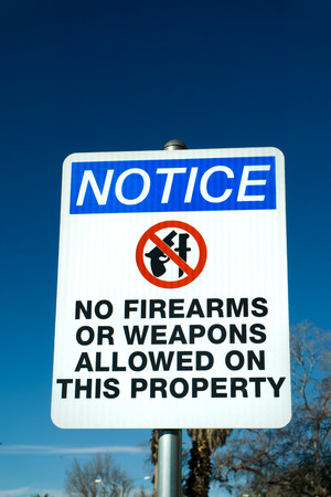 red circle: No firearms or weapons with red circle sign.