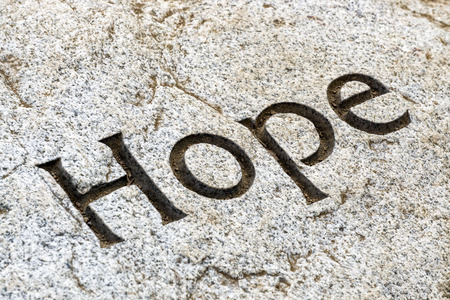 etched: The word Hope etched in white rock.