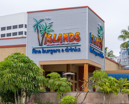specializes: LONG BEACH, CAUSA - MARCH 19, 2016: Islands Fine Burgers & Drinks exterior and logo. Islands is a casual dining restaurant chain that specializes in hamburgers. Editorial