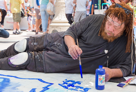 chalks: PASADENA, CAUSA - JUNE 21, 2015: Unidentified artist participating in the 2015 Pasadena Chalk Festival at Paseo Colorado.