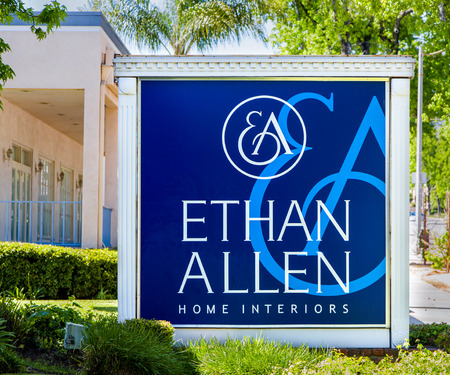 ethan: PASADENA, CAUSA - APRIL 16, 2016: Ethan Allen Home Interiors exterior and sign. Ethan Allen Global, Inc. is an American luxury furniture chain.