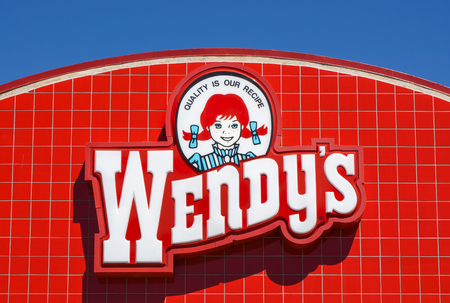 approximately: PALMDALE, CAUSA - APRIL 23, 2016: Wendys fast food restaurant exterior and sign. Wendys is the worlds third largest hamburger fast food chain with approximately 6,650 locations.