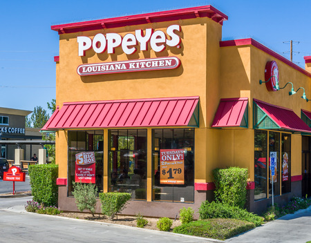 soul food: PALMDALE, CAUSA - APRIL 23, 2016: Popeyes Louisiana Kitchen exterior. Popeyes Louisiana Kitchen is an American chain of fried chicken fast food restaurants.