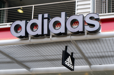 adidas: SANTA MONICA, CAUSA - MAY 12, 2016: Adidas retail store exterior and logo. Adidas is a German multinational corporation that designs and manufactures sports shoes, clothing and accessories. Editorial