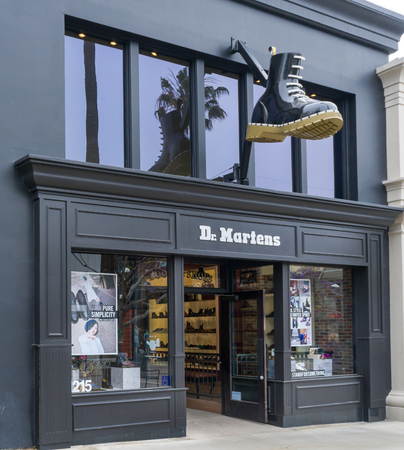 dms: SANTA MONICA, CAUSA - MAY 12, 2016: Dr. Martens retail store exterior and logo. Dr. Martens is a British footwear and clothing brand.