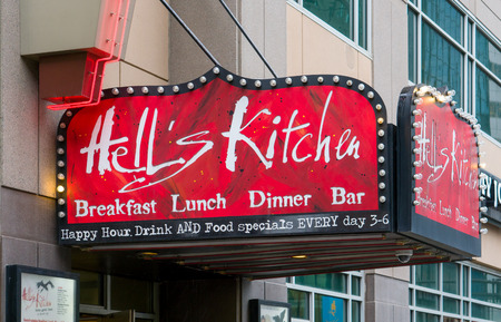 unconventional: MINNEAPOLIS, MNUSA - MAY 28, 2016: Hells Kitchen resturaunt exterior sign and logo. Hells Kitchen is a restaurant in downtown Minneapolis, Minnesota.