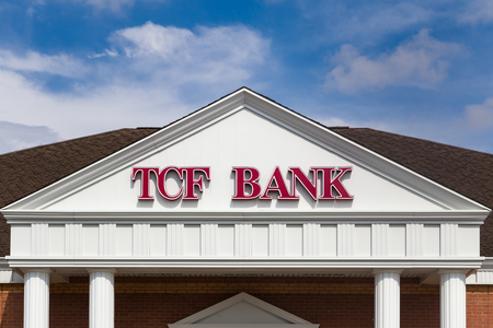 bank owned: BLOOMINGTON, MNUSA - MAY 25, 2016: TCF Bank exterior and logo. TCF Bank is the wholly owned banking subsidiary of TCF Financial Corporation.