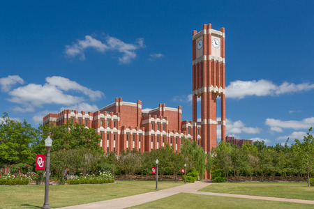 NORMAN, OKUSA - MAY 20, 2016: Campus clock tower at Bizzel Memorial Library on the campus of the University of Oklahoma. Editorial