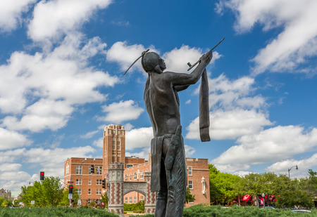 NORMAN, OKUSA - MAY 20, 2016: May We Have Peace Bronze Statue by Allan Houser at the University of Oklahoma  at the University of Oklahoma.