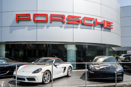 automobile dealership: LOS ANGELES, CAUSA - JULY 31, 2016: Porsche automobile dealership exterior. Porsche Auomobil Holding is a German holding company with investments in the automotive industry.