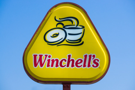 LOS ANGELES, CAUSA - JULY 31, 2016: Winchells Donut sign and logo. Winchells Donuts is an international doughnut company founded in California.