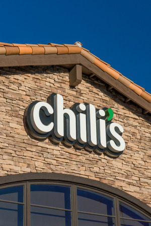 chili's restaurant: SANTA CLARITA, CAUSA - SEPTEMBER 23, 2016: Chilis restaurant exterior and logo. Chilis Grill & Bar is an American casual dining restaurant chain that features Tex-Mex-style cuisine. Editorial