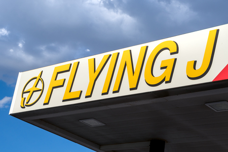 barstow: BARSTOW, CAUSA - SEPTEMBER 30, 2016: Flying J truck stop exterior and logo. Flying J, is a chain of truck stops in the United States and Canada. Editorial