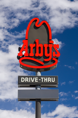 drive through: EVANSTON, WYUSA - OCTOBER 2, 2016 Arbys restaurant exterior and sign. Arbys is the second largest fast food sandwich chain in the United States. Editorial