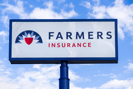 PROVO, UT/USA - OCTOBER 2, 2016: Farmers Insurance sign and Logo. Farmers Insurance Group is an American insurer group of automobiles, homes and small businesses. Publikacyjne