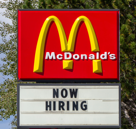 EVANSTON, WYUSA - OCTOBER 2, 2016: Now hiring sign at McDonalds restaurant. McDonalds is a world wide fast food company. Editorial