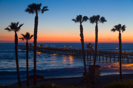 Beautiful ocean sunset at San Clemente Pier in Southern California, United States.