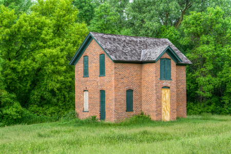 Abandoned brick farmhouse in the United States Midwest.