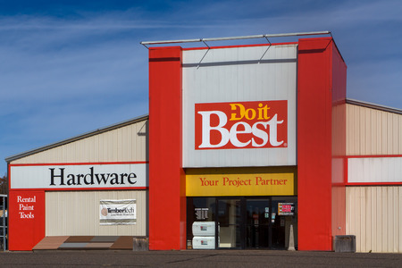ST. CROIX FALLS, WIUSA - OCTOBER 16, 2016: Do it Best hardware store exterior and logo. Do it Best Corp., Inc. is a member-owned hardware, lumber, and building materials cooperative.