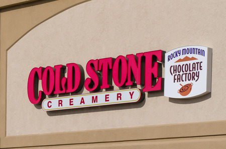 creamery: HUDSON, WIUSA - OCTOBER 21, 2016: Cold Stone Creamery and Rocky Mountain Chocolate Factory co-branded exterior and logo.
