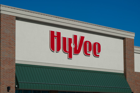 the throughout: WOODBURY, MNUSA - NOVEMBER 13, 2016: Hy-Vee grocery store exterior and logo. Hy-Vee is an employee-owned chain of more than 240 supermarkets located throughout the Midwestern United States.