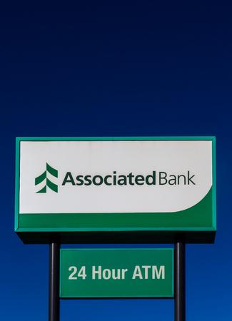 associated: HUDSON, WIUSA - NOVEMBER 13, 2016: Associated Bank sign and logo. Associated Banc-Corp a U.S. regional bank holding company.