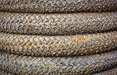 Macro image of coiled rope up close.