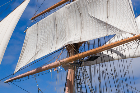tall ship: Vintage tall ship rigging and sails against blue sky.