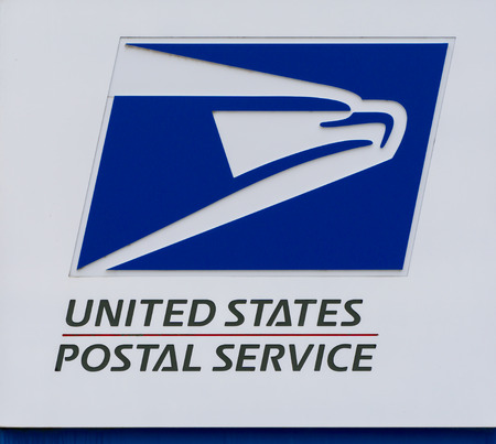 STILLWATER, MNUSA - NOVEMBER 20, 2016: United States Postal Service sign and logo. Фото со стока