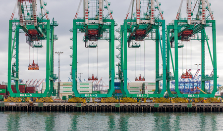 SAN PEDRO, CAUSA - JANUARY 18, 2016: Evergreen Marine Corporation Container Cranes at Port of Los Angeles.