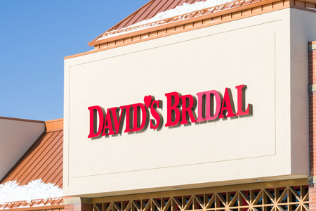 specializes: MINNEAPOLIS, MNUSA - JANUARY 14, 2017: Davids Bridal retail store and logo. Davids is a clothier in the United States that specializes in wedding dresses, prom gowns, and other formal wear.