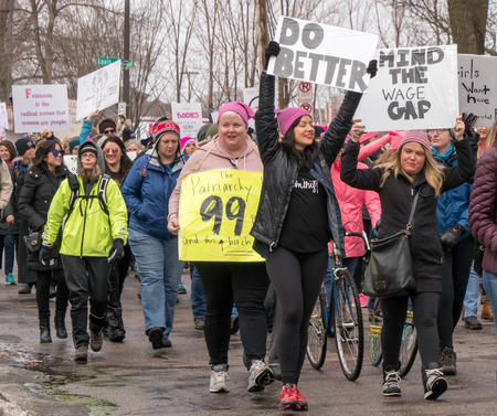 ST. PAUL, MNUSA - JANUARY 21, 2016: Unidentified particpants at the 2017 Womens March Minnesota. The Womens March represented the worldwide protest to protect womens rights and other causes.