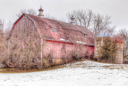 western usa: Aging and distressed red barn in western Wisconsin, USA. Stock Photo