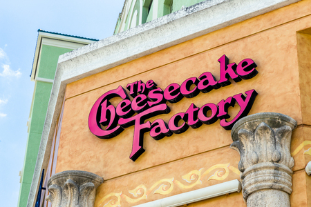 FORT LAUDERDALE, FLAUSA - APRIL 10, 2017: The Cheesecake Factory exterior sign and logo. The Cheesecake Factory, Inc. is a restaurant company and distributor of cheesecakes based in the United States.